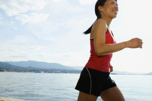 Woman jogging by lake