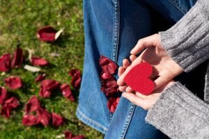person-holding-heart-shaped-cut-out-1820525